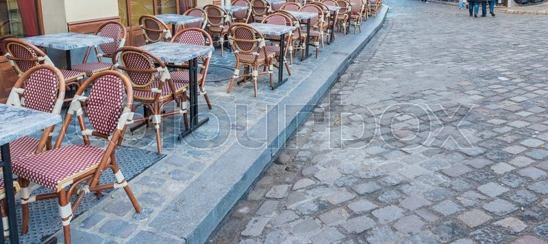 Stock image of 'Chairs ansd tables of Montmartre. Romantic street of Paris.'