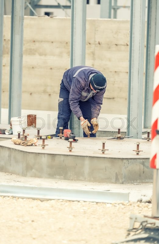 Stock image of 'Worker on a construction site.'