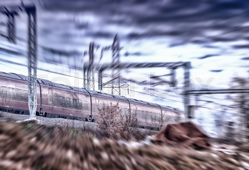 Stock image of 'Fast moving train on a cloudy day. Industrial concept.'