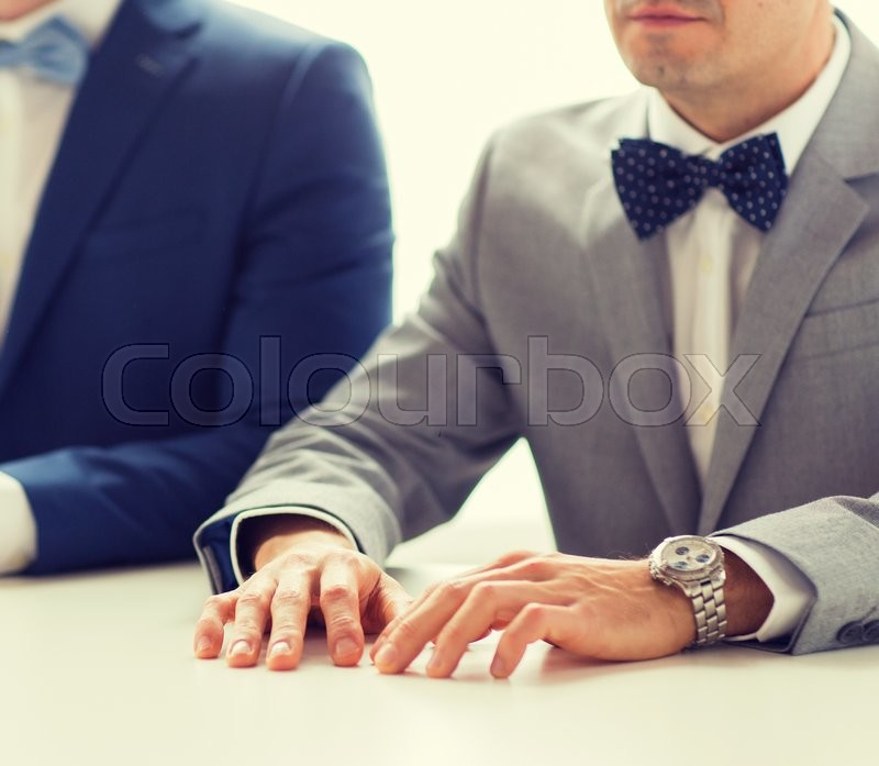Stock image of 'people, homosexuality, same-sex marriage and love concept - close up of happy male gay couple hands on wedding'