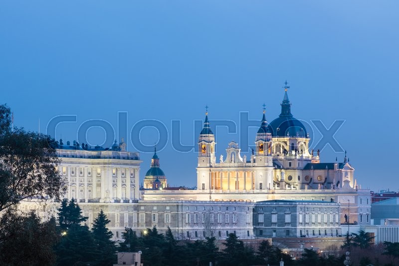 Stock image of 'Madrid, Spain skyline at Santa Maria la Real de La Almudena Cathedral and the Royal Palace. '