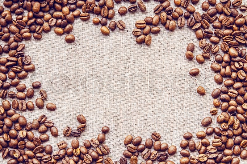 Stock image of 'coffee beans on texture canvas '