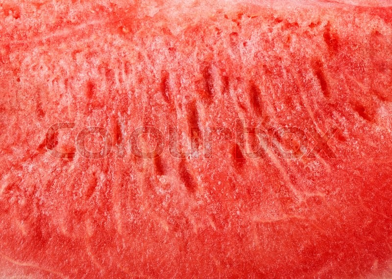 Stock image of 'ripe watermelon sliced red background close-up'