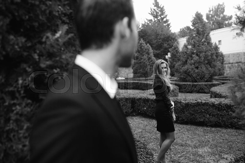 Stock image of 'girl standing near guy in the background at the park'