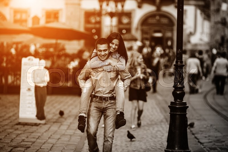 Stock image of 'man and woman posing and have fun in the old town'