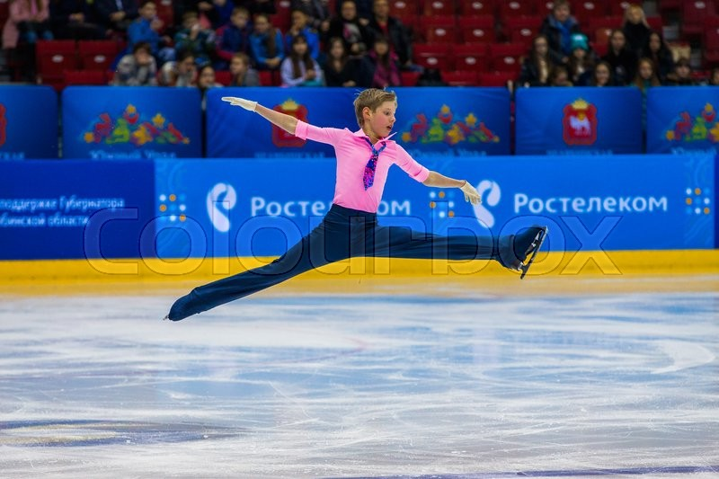 Editorial image of 'Chelyabinsk, Russia -  January 21, 2016: young athlete skater male performance in short program on ice during Championship of Russia figure skating juniors'