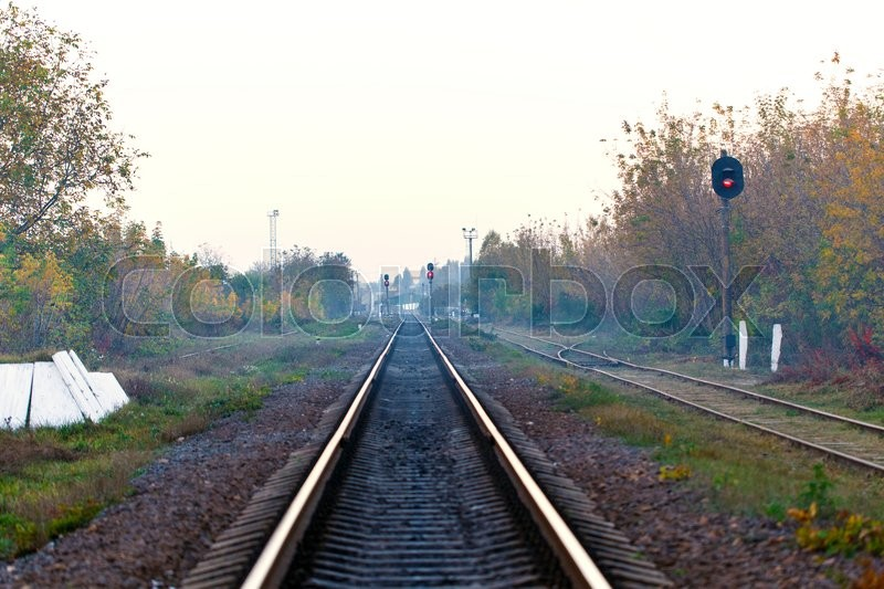 Stock image of 'railroad tracks Transportation day leaving for horizon'
