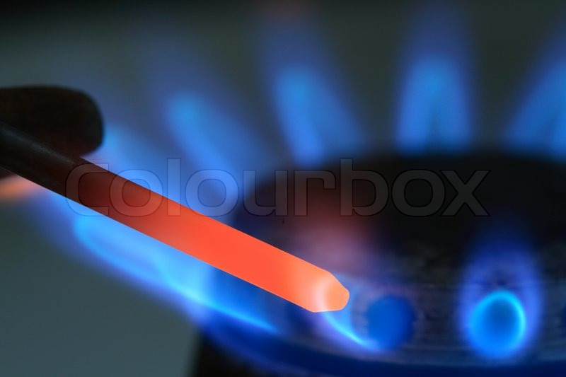 dunkler hintergrund mit wei gl henden nagel und blaue gasflamme stockfoto colourbox. Black Bedroom Furniture Sets. Home Design Ideas