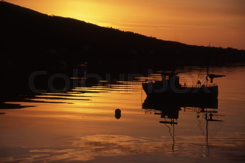 Stock image of 'Fishing boat in sunset/sunrise in Norway'