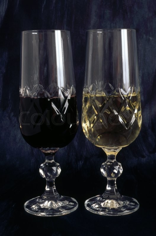 Stock image of 'Two glasses of red wine and white wine isolated on black background'