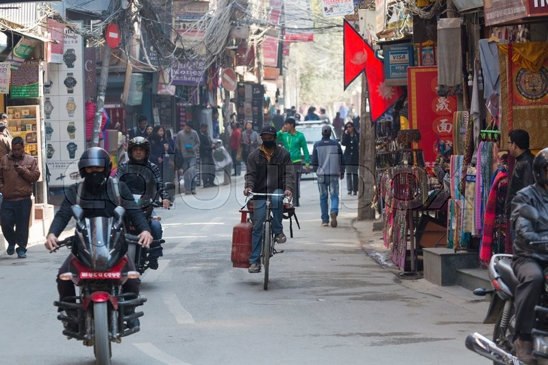 Stock image of 'KATHMANDU, NEPAL - FEBRUARY 10, 2015: The streets of Kathmandu, Nepal, near Dubar square. Masses of people, rickshaws and Motorbikes crowd through the streets, 10, 2015 in Kathmandu, Nepal.'