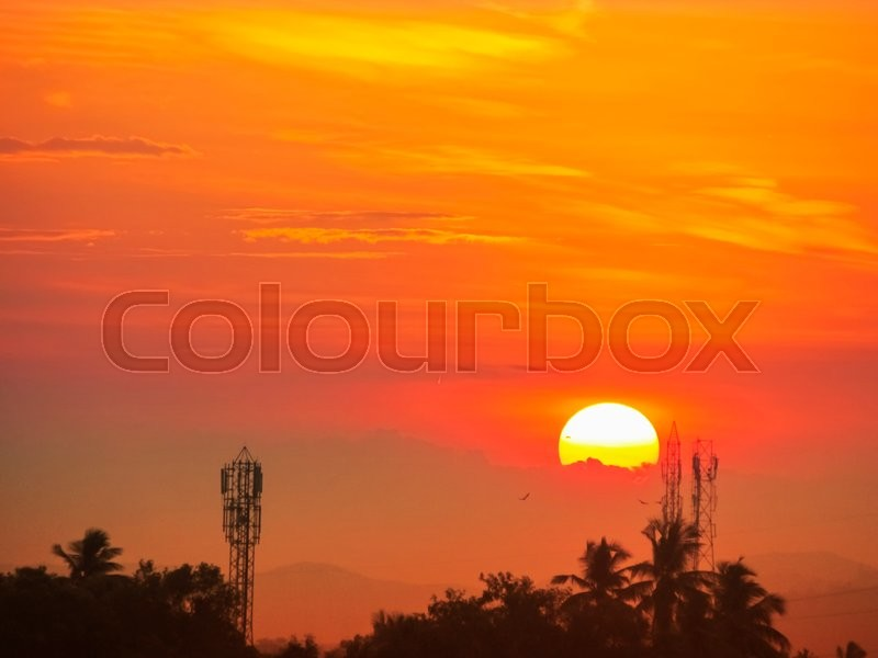Stock image of 'Sunset with telecom tower in foreground -a silhouette'