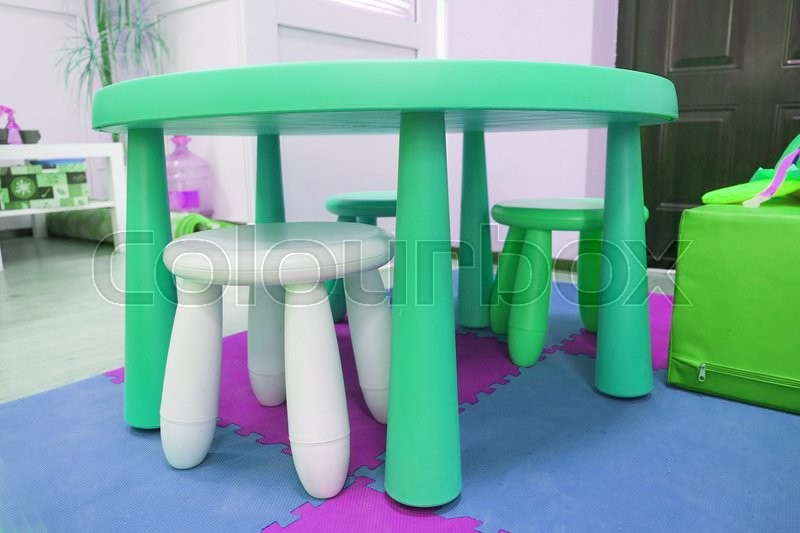 Colorful plastic kid chairs and table, stock photo