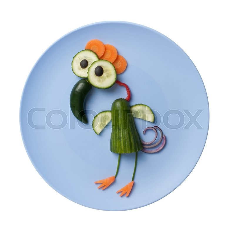 Stock image of 'Funny bird made of vegetables on blue plate'