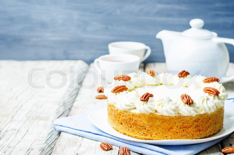 Stock image of 'carrot cake cheesecake with pecan on a white wood background. toning. selective Focus'