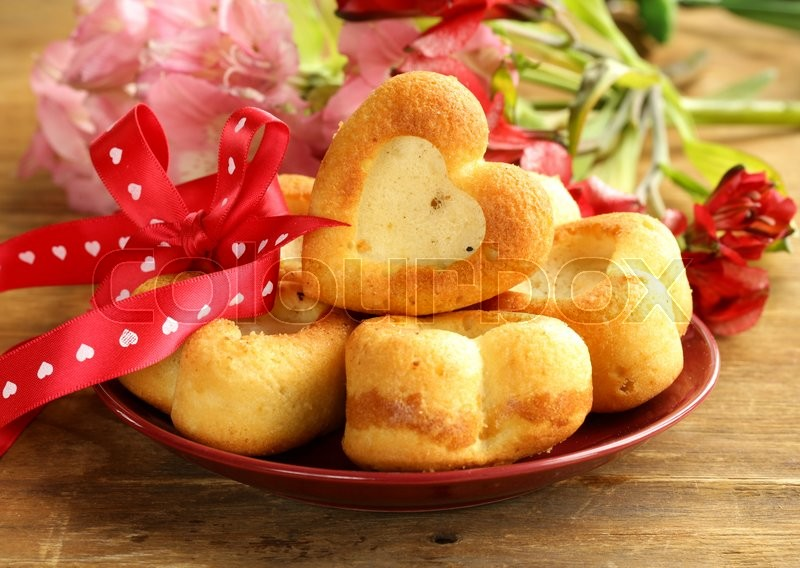 Stock image of 'muffins in the shape of a heart - sweet gift for Valentine's Day'