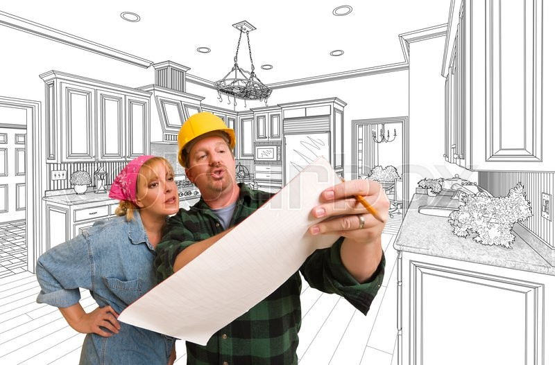 Stock image of 'Male Contractor in Hard Hat Discussing Plans with Woman, Kitchen Drawing Behind.'