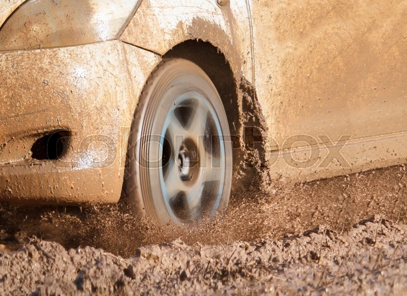 Stock image of 'Car on muddy road'