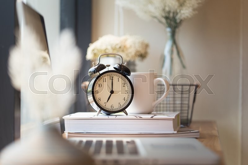 Stock image of 'Photo of clock on office desk.'