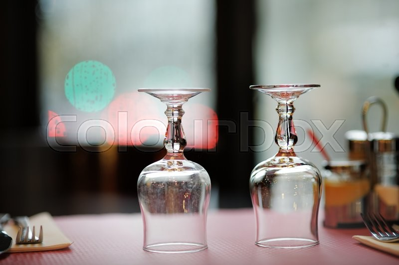 Stock image of 'Wine glasses on a table in a restaurant'