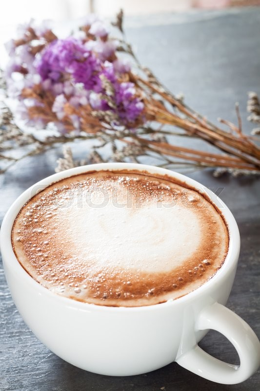 Stock image of 'Coffee cup with beautiful violet flower, stock photo'