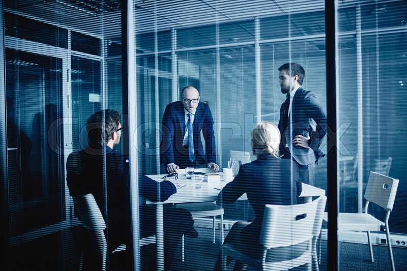 Stock image of 'Group of young managers having meeting in office'