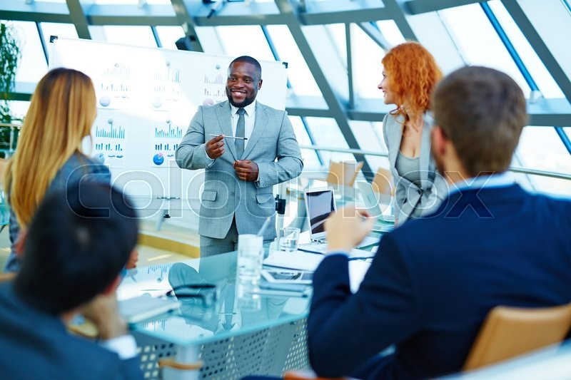 Stock image of 'Business people discussing together during a meeting'