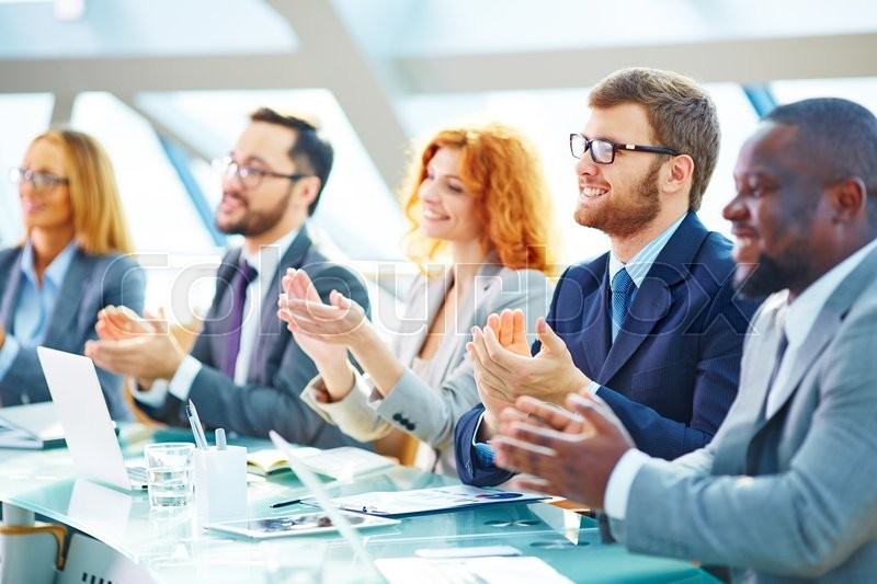 Stock image of 'Business people applauding at the conference'