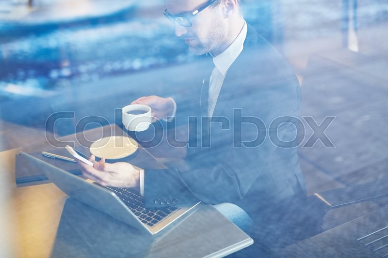 Stock image of 'Modern employee working in cafe'