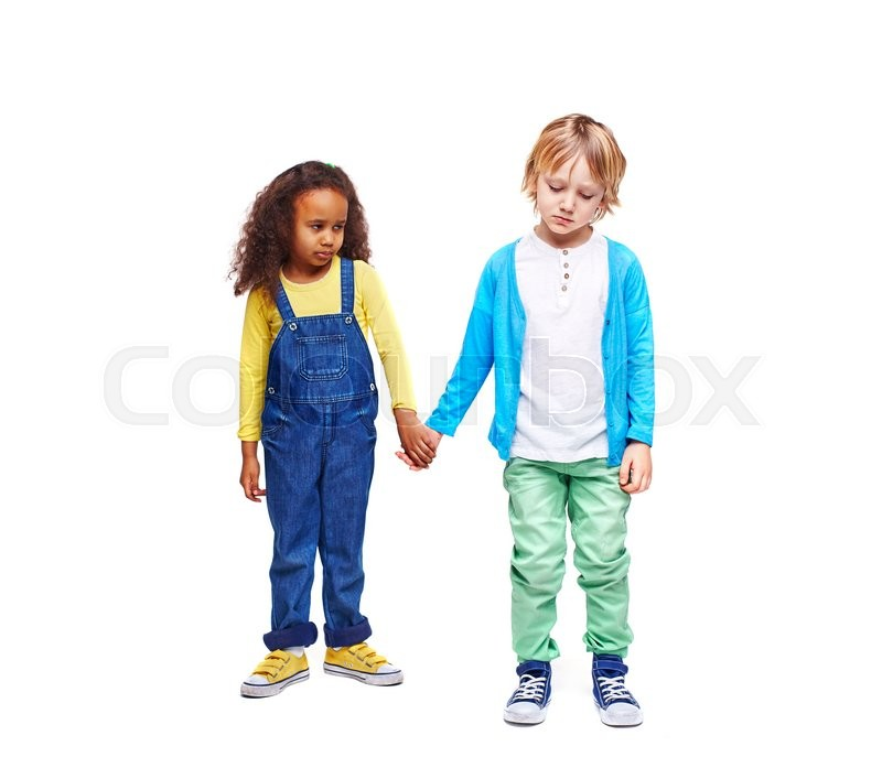 Stock image of 'Sulky kids in casual-wear holding by hands'