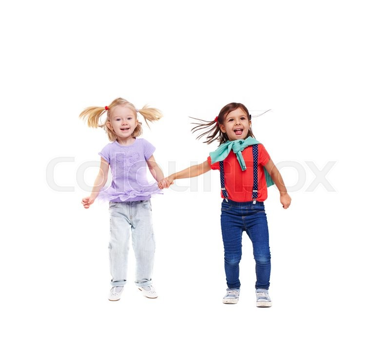 Stock image of 'Two cute girls in casual-wear holding by hands'