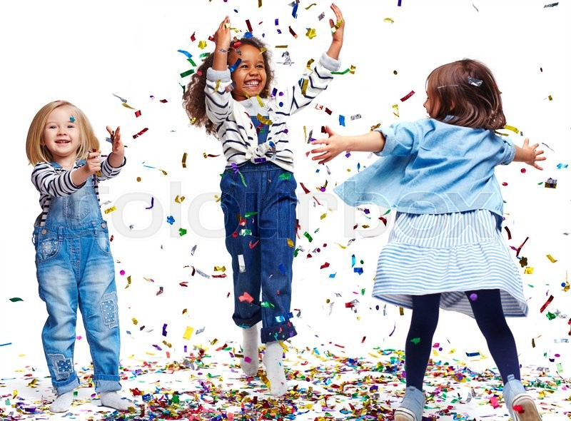 Stock image of 'Little ecstatic girls playing with confetti'