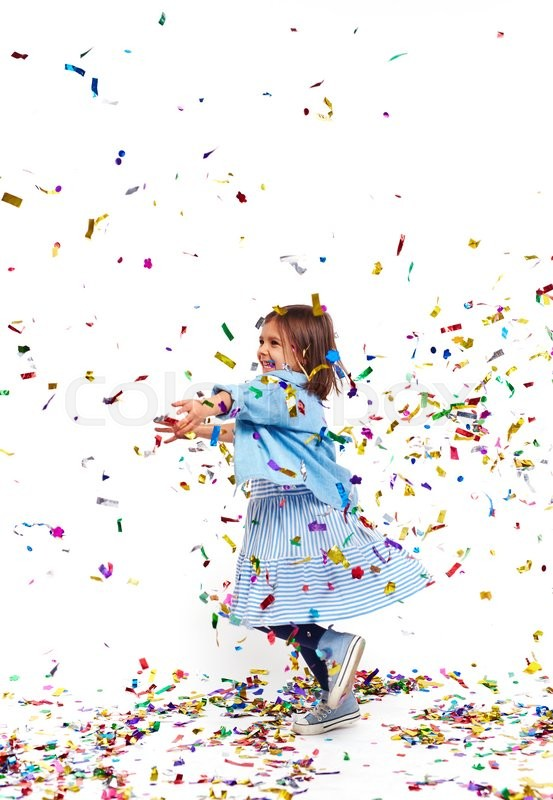 Stock image of 'Carefree girl playing with confetti and laughing'