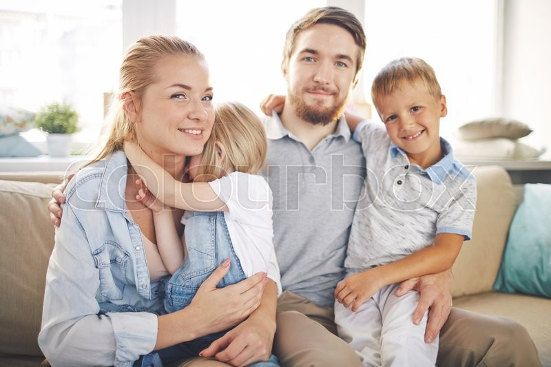 Stock image of 'Happy family having rest at home'