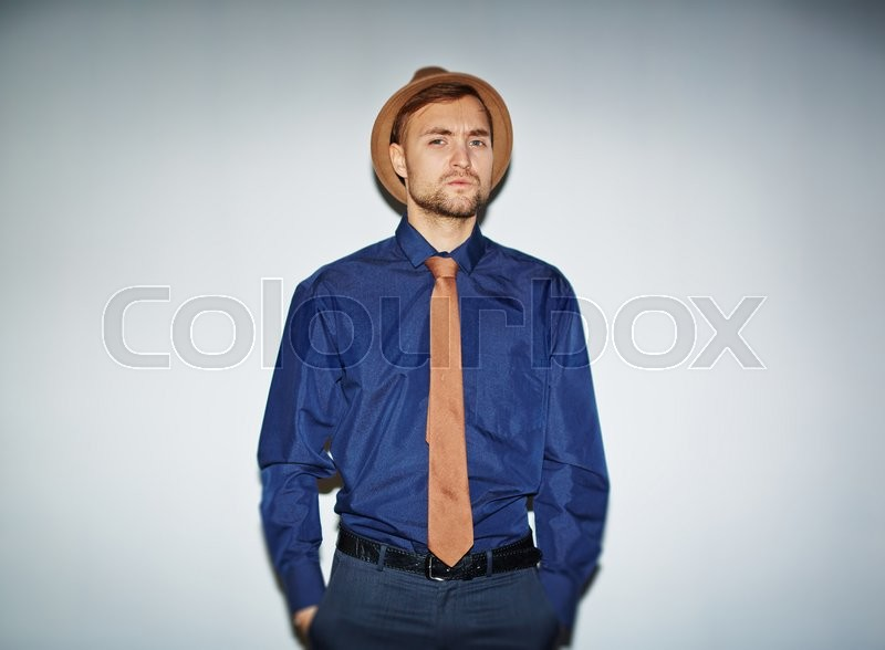 Stock image of 'Elegant man in hat, tie and blue shirt looking at camera'