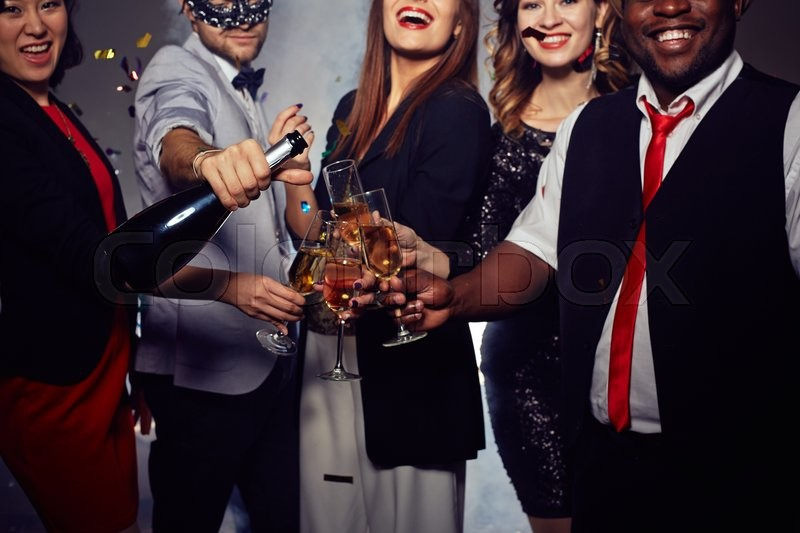 Stock image of 'Group of friends toasting and celebrating New Year'