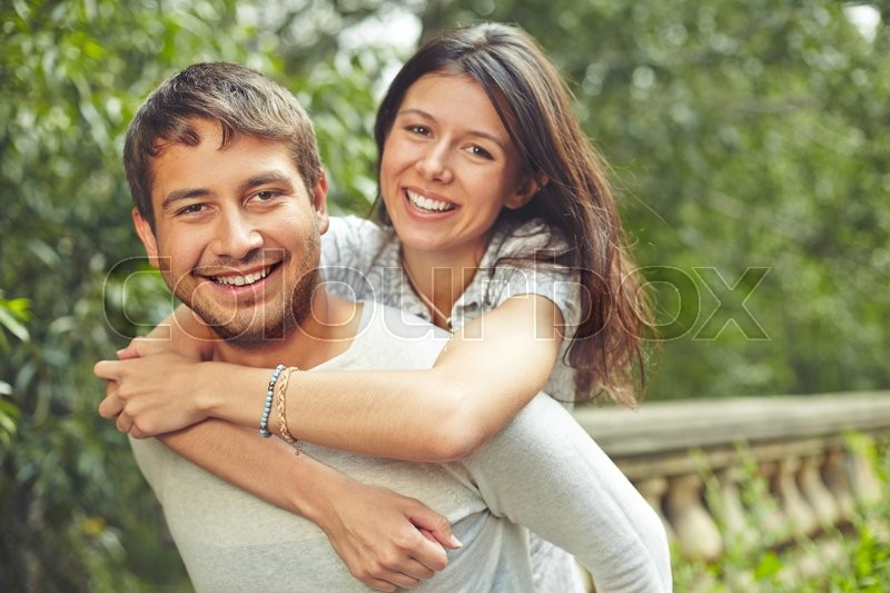 Stock image of 'Happy dates looking at camera outdoors'