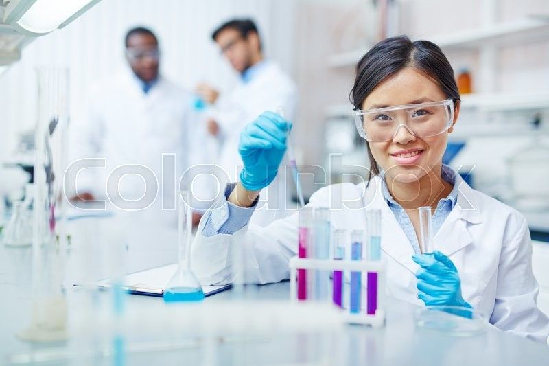 Stock image of 'Young laboratory worker looking at camera'