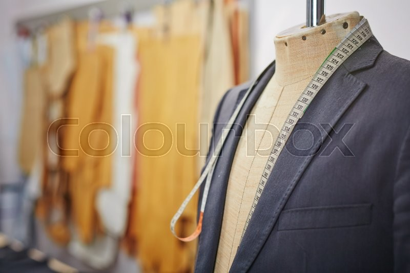 Stock image of 'New jacket on mannequin and measuring tape'