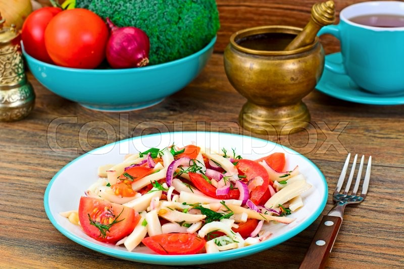 Stock image of 'Salad with Squid, Tomato, Red Onion, Vegetable Oil Studio Photo'