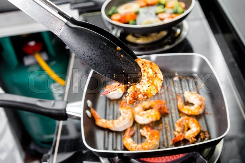 Stock image of 'chef grilled shrimps steak in a pan'