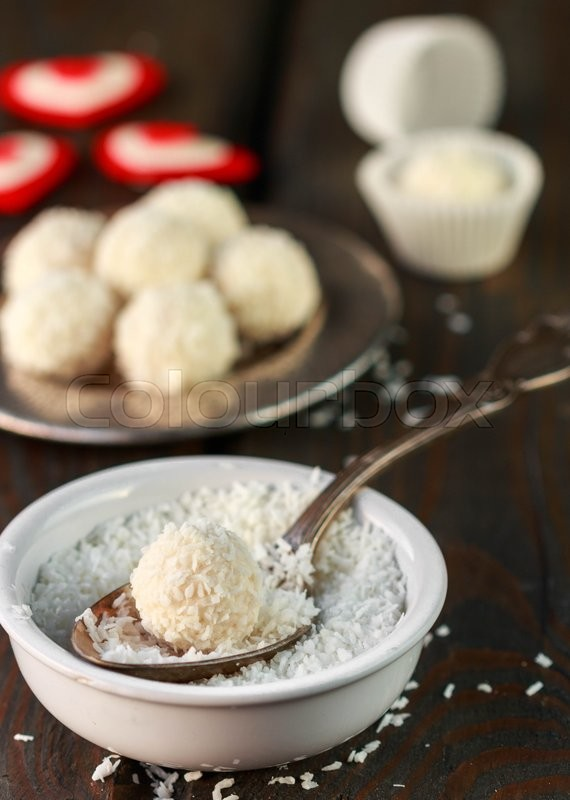 Stock image of 'Homemade candy white chocolate with coconut. Coconut balls. Selective focus'