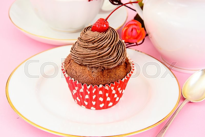 Stock image of 'Cake with Cream and Cherry, Cupcake. Sweet Food'