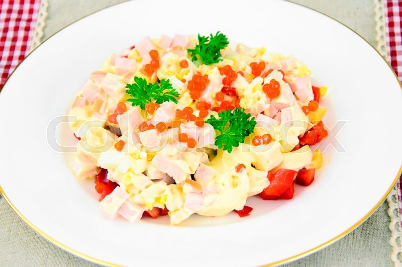 Stock image of 'Salad with Ham, Peppers, Cheese and Egg. Studio Photo'