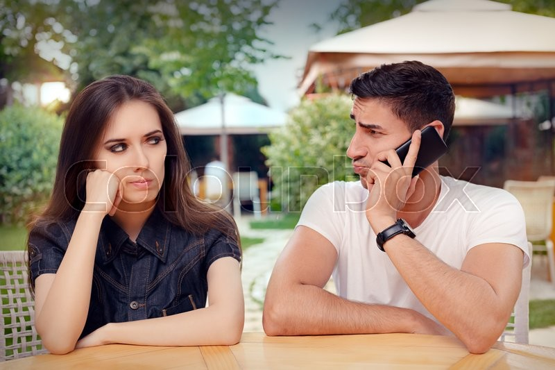Stock image of 'Unhappy girlfriend spying on her loved one eavesdropping private conversation'