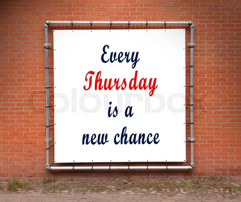 Stock image of 'Large banner with inspirational quote on a brick wall - Every thursday is a new chance'