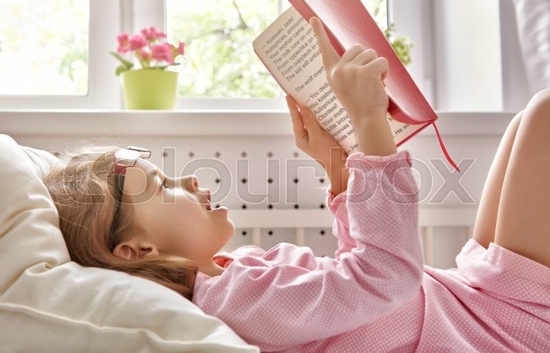 Stock image of 'cute child girl reading a book. self learning'