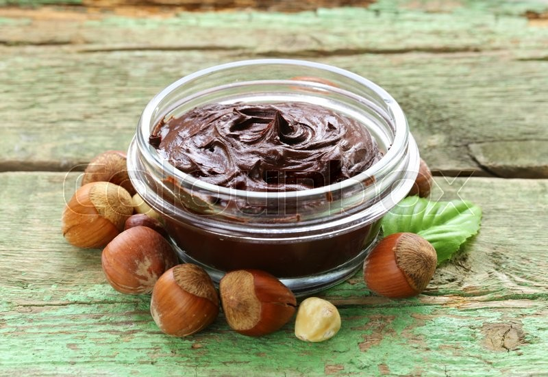 Stock image of 'sweet chocolate hazelnut spread with whole nuts'