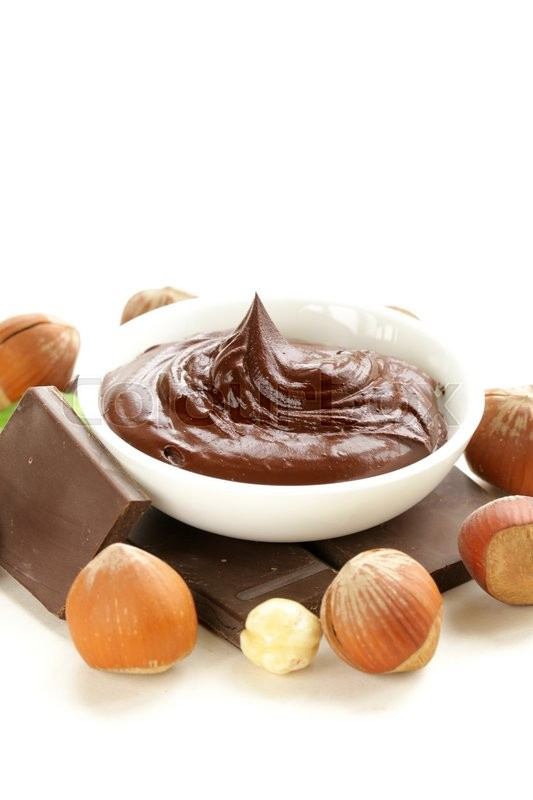 Stock image of 'chocolate hazelnut spread on a white background'