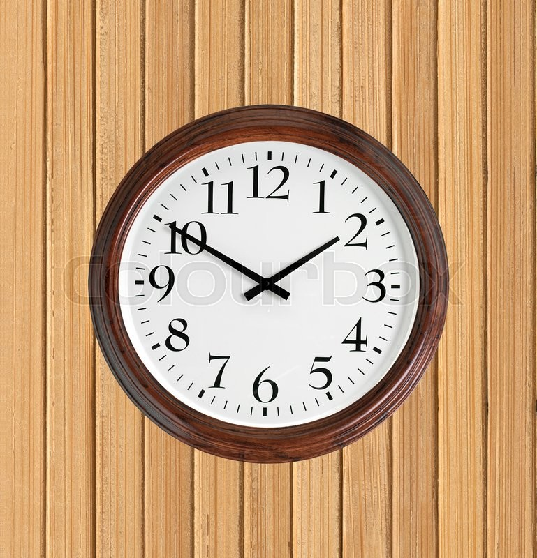 Stock image of 'Wall clock with wooden frame on wooden planks background'